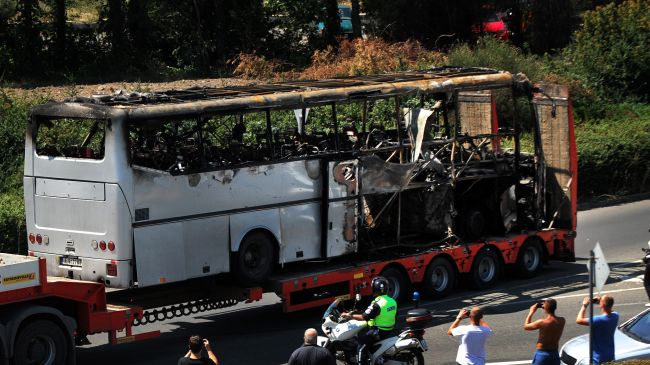 A truck carries the bus damaged by a bomb blast which targeted a group of Israeli tourists at the airport in Bourgas, Bulgaria, on July 19, 2012.