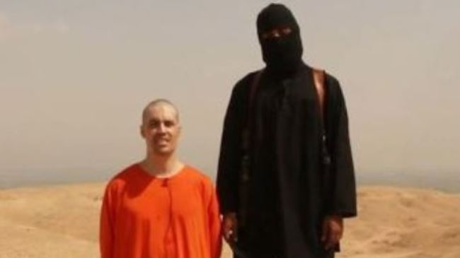 A frame grab of a graphic video showing American freelance journalist James Foley (seen on the left) being decapitated by a terrorist.
